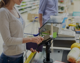 woman paying a payment card in a shop